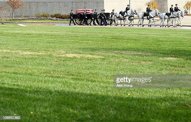 Members of the US Army's 3rd Infantry Regiment 'The Old Guard' escort the caisson carrying the flagdraped casket that holds the remains of Army Staff...