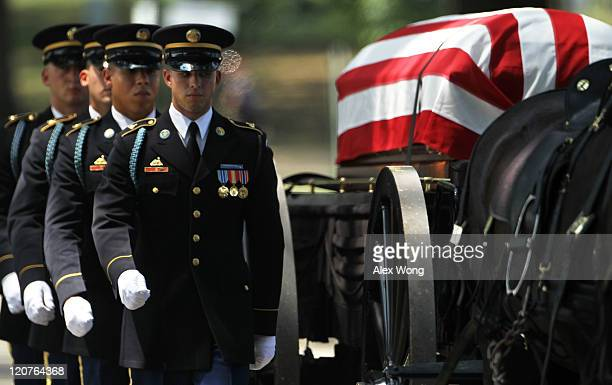 Members of the US Army's 3rd Infantry Regiment 'The Old Guard' escort the flagdraped casket of the late Army Pfc Dylan J Johnson of Tulsa Oklahoma to...