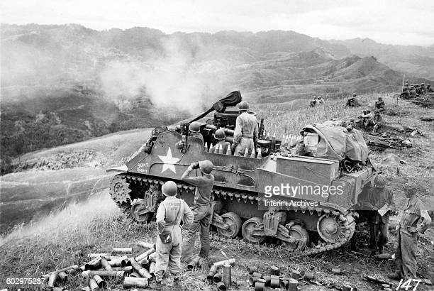 Members of the US Army's 40 Infantry man a M7 Priest nicknamed Super Rabbit and armed with a 105mm howitzer while standing guard overlooking the...