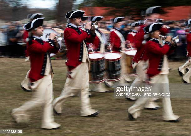 TOPSHOT Members of the US Army's Old Guard Fife and Drum Corps take part in Presidents day events at George Washingtons' Mount Vernon estate in Mt...