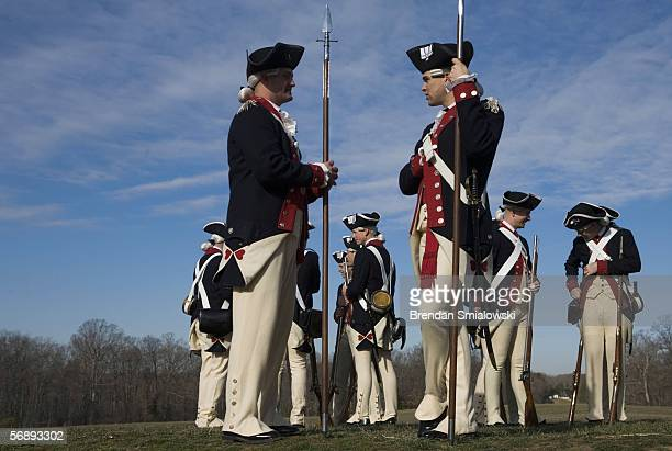 Members of the US Army's Old Guard prepare for a Revolutionary War era battle demonstration at the Mount Vernon Estate and Gardens on Presidents Day...
