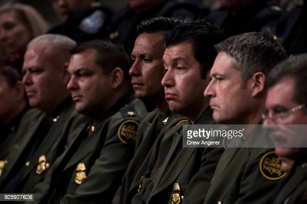 Members of the US Border Patrol attend an event to mark the 15th anniversary of the Department of Homeland Security March 1 2018 in Washington DC The...