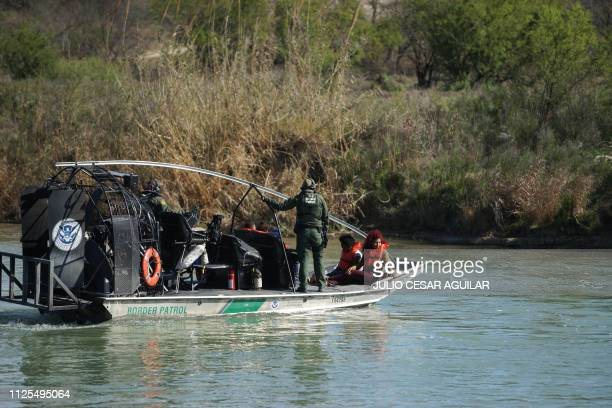 Members of the US Border Patrol detain Central American migrants trying to cross the Rio Bravo from Piedras Negras in Coahuila state Mexico to Eagle...