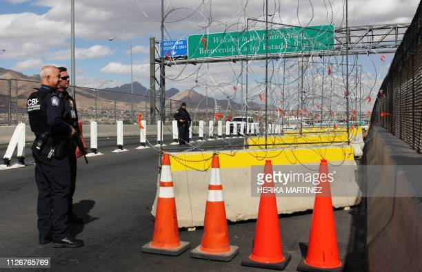 Members of the US Border Patrol look as barbed-wire barriers are being installed ahead of the possible massive arrival of migrants, at the Zaragoza...