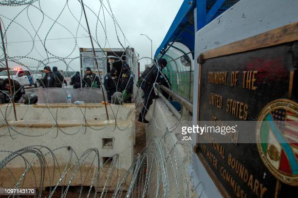Members of the US Border Police guard the international bridge in Texas, as seen from Piedras Negras, Coahuila state, Mexico, on February 10, 2019. -...