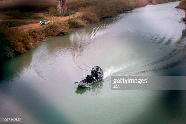 Members of the US Border Police guard the Rio Bravo, natural border between Eagle Pass, Texas and Piedras Negras, Coahuila state, Mexico, as seen...