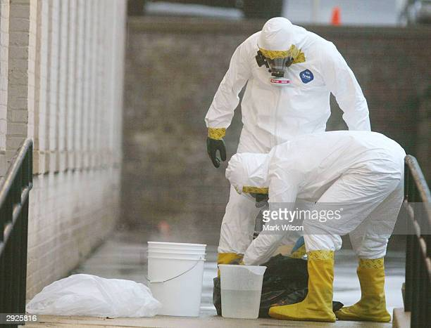 Members of the U.S. Capitol Police HAZMAT Team perform a cleaning process after searching through a Escalade SUV used by US Senate majority leader...