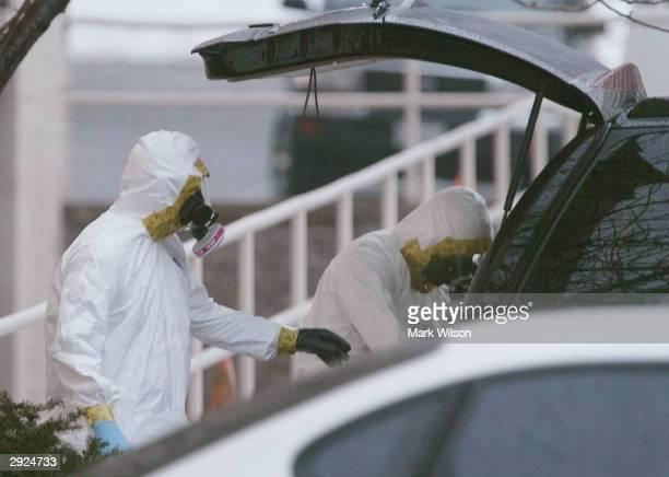 Members of the U.S. Capitol Police HAZMAT Team prepare to search through an Escalade SUV used by U.S. Senate majority leader and U.S. Senator Bill...