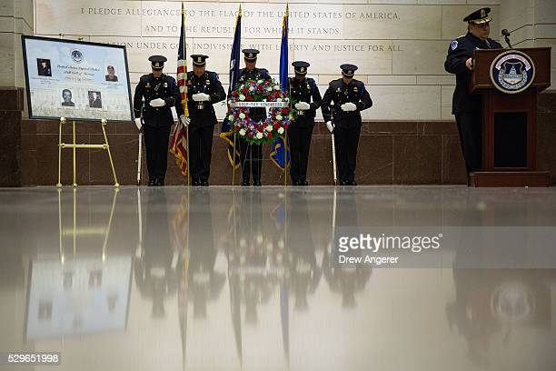Members of the US Capitol Police Honor Guard stand behind a memorial wreath during an annual memorial service in honor of the four US Capitol Police...