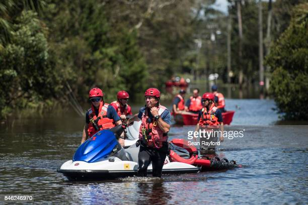 Members of the US Coast Guard and local first responders conduct rescue operations in flood waters caused by Hurricane Irma September 12 2017 in...