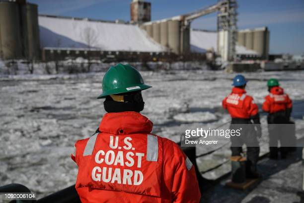 Members of the US Coast Guard prepare to dock the USCGC Penobscot Bay an icebreaking tugboat of the US Coast Guard at the Port of Albany February 1...