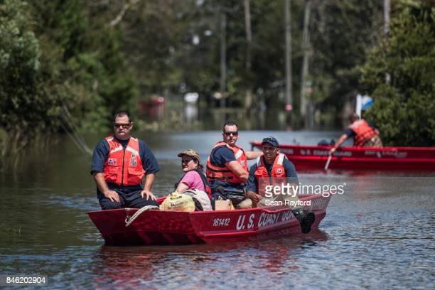 Members of the US Coast Guard rescue a woman from flood waters caused by Hurricane Irma Sept 12 2017 in Hastings Florida United States The storm...