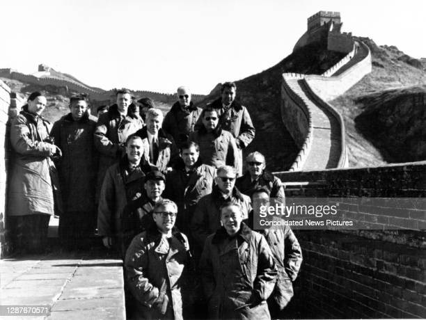 Members of the US delegations pose with Chinese hosts on Great Wall of China, China, October 22, 1971. Pictured are, front row, from left, US...