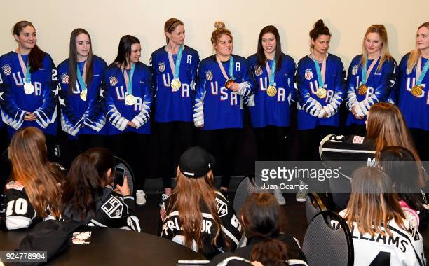 Members of the US Gold Medal Winning Womens Olympic Hockey Team participate in a special meetandgreet with the LA Lions the allgirls hockey club...