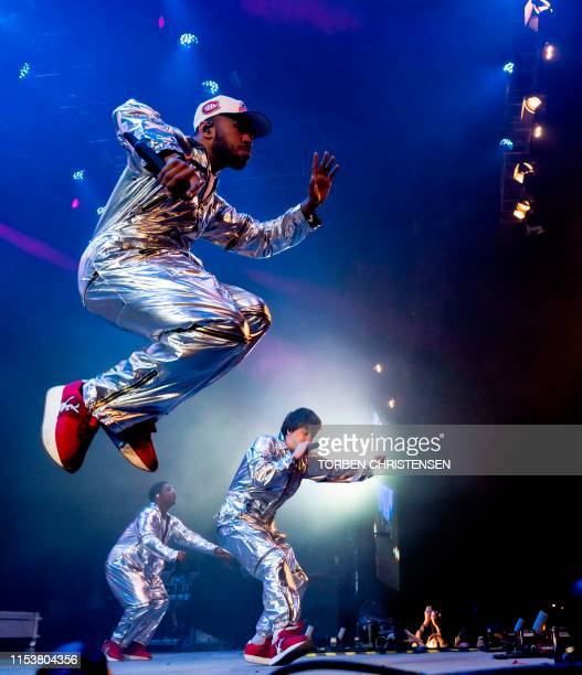 Members of the US hiphop band Brockhampton perform at Arena Scenen during the Roskilde Festival on July 4 2019 in Roskilde Denmark / Denmark OUT