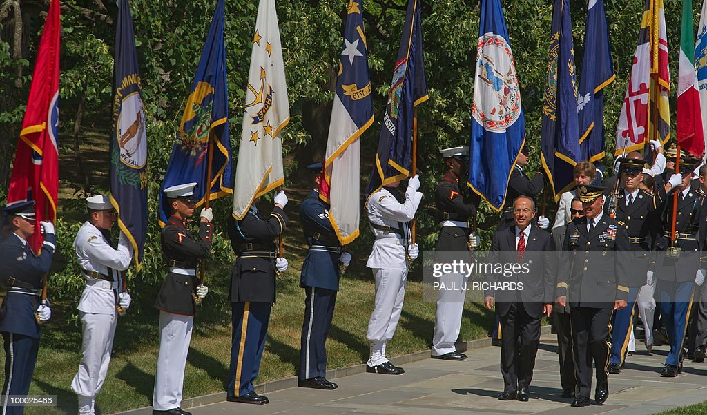 Members of the US Honor Guard hold flags as Mexican President Felipe