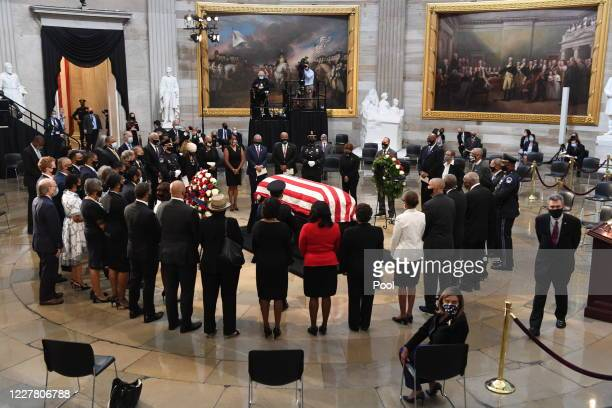Members of the U.S. House of Representatives circle the casket of Rep. John Lewis in the Capitol Rotunda on July 27, 2020 in Washington, DC. Lewis, a...
