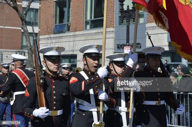 Members of the US Marine Band from Camp LeJeune take part in the 117th Annual St Patrick's Day Parade on March 18 2018 in Boston Massachusetts