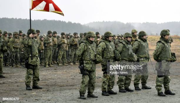 Members of the US Marine Corps and the Japanese Ground SelfDefense Force attend the opening ceremony of their joint drill at a JGSDF exercise area in...