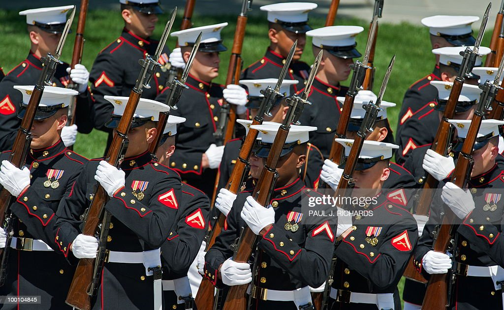 Members of the US Marine Corps Honor Guard turn a corner and march up the steps of the Tomb of the Unknown Soldier during ceremonies for Mexican President Felipe Calderon May 20, 2010, at Arlington National Cemetery in Arlington, Virgina. AFP Photo/Paul J. Richards