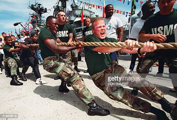 Members of the US Marine Corps TugOfWar team let out a scream as they pull against the New York City Police team 24 May during Fleet Week '97 events...