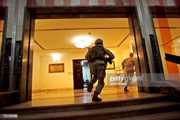 Members of the US Marine Security Force run through the American Embassy February 6 2007 in Baghdad Iraq The platoon of Marines from the...