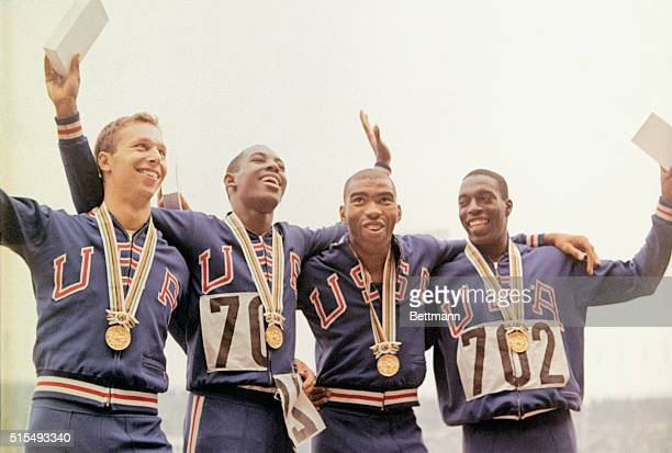 Members of the U.S. Men's 400 meter relay team pose with their gold medals after victory ceremonies during the 1964 Summer Olympic Games in Tokyo,...