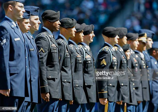 Members of the US Military are honored as part of Salute to Armed Forces Day prior to the game between the Seattle Mariners against the Texas Rangers...