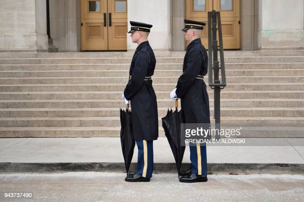 Members of the US military await an honor cordon with US Secretary of Defense James Mattis and Qatar's Emir Sheikh Tamim Bin Hamad AlThani at the...