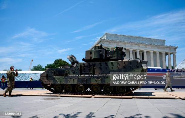 Members of the US military guide a Bradley Fighting Vehicle as preparations are made for the Salute to America Fourth of July event with US President...