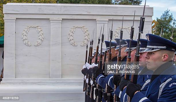 Members of the US military Honor Guard stand next to the Tomb of the Unknown Soldier during ceremonies with Australian Foreign Minister Julie Bishop...