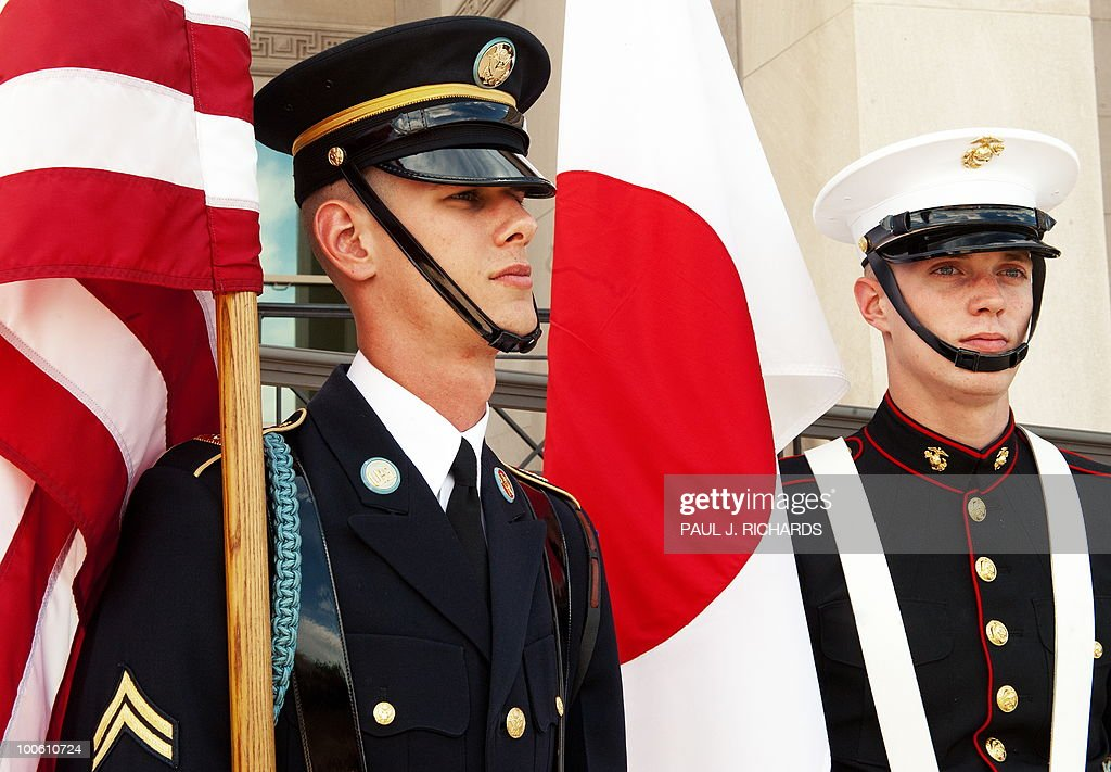 Members of the US Military Honor Guard wait for ceremonies to begin with US Secretary of Defense Robert Gates and Japanese Defense Minister Toshimi Kitazawa shortly before their private meetings ON May 25, 2010 at the Pentagon in Washington. AFP PHOTO/Paul J. Richards