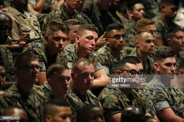 Members of the US military listen to President Donald Trump deliver remarks on American involvement in Afghanistan at the Fort Myer military base on...