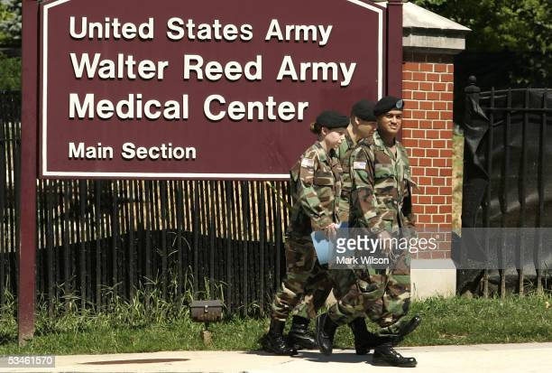 Members of the US Military walk out of the gate at Walter Reed Army Medical Center August 25 2005 in Washington DC Earlier today the Base Realignment...