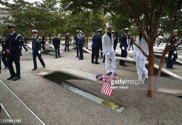 Members of the US Military walk through a 911 memorial during a ceremony at the Pentagon to commemorate the anniversary of the 9/11 terror attacks...