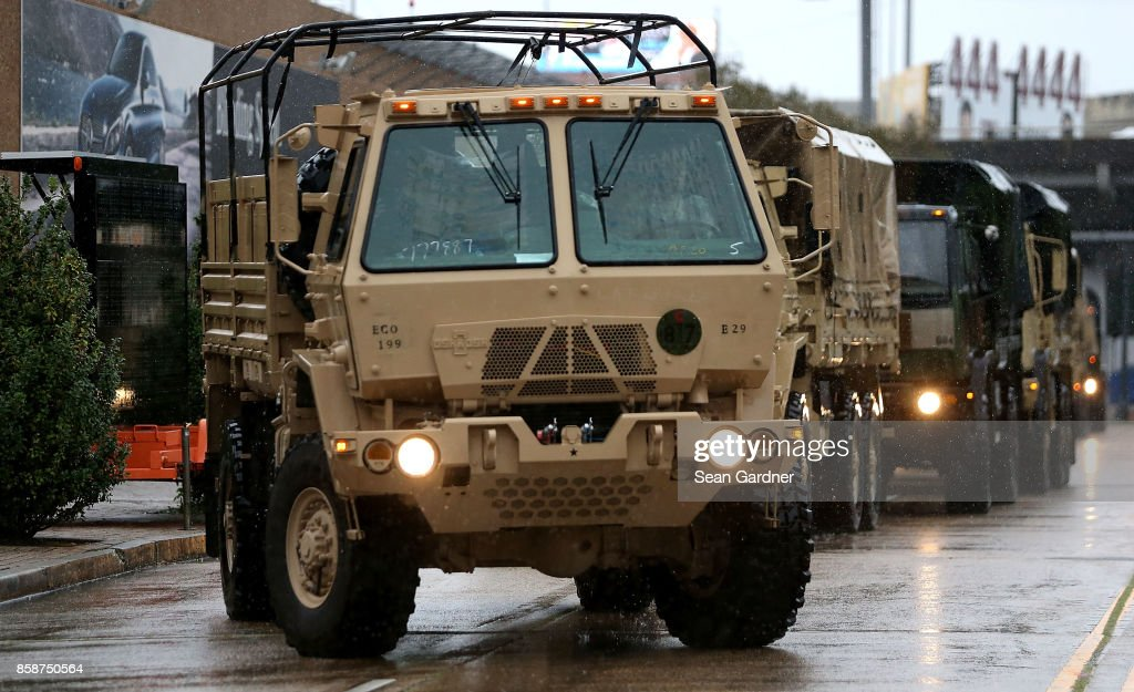 Members of the U.S. National Guard arrive at the Mercedes-Benz Superdome as New Orleans prepares for Hurricane Nate on October 7, 2017 in New Orleans, Louisiana. Nate is expected to make landfall as a category 2 hurricane near Biloxi, Mississippi later this evening.