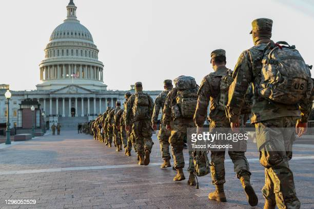 Members of the U.S. National Guard arrive at the U.S. Capitol on January 12, 2021 in Washington, DC. The Pentagon is deploying as many as 15,000...