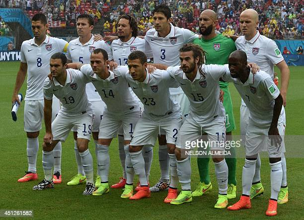 Members of the US national team pose for a picture prior to a Group G football match between US and Germany at the Pernambuco Arena in Recife during...