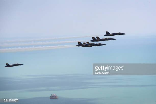 Members of the U.S. Navy Blue Angels fly past the 360 Chicago observation deck as a tribute to healthcare and frontline workers on May 12, 2020 in...