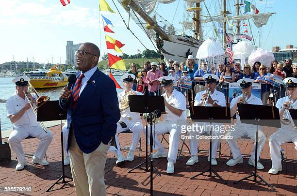 Members of the US Navy Ceremonial Band perform behind Al Roker during a taping of the 'Today Show' at Baltimore's Inner Harbor during Baltimore Navy...