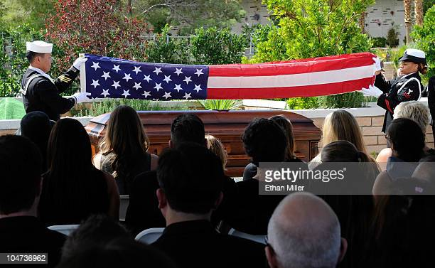 Members of the US Navy honor guard fold an American flag over the coffin of actor Tony Curtis during his funeral at Palm Mortuary Cemetary October 4...