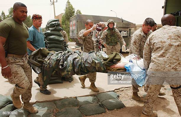 Members of the US Navy medical corps of the Bravo Surgical Company Medevac a US Marine with a head wound on April 30 2004 in Fallujah IraqThe Marine...
