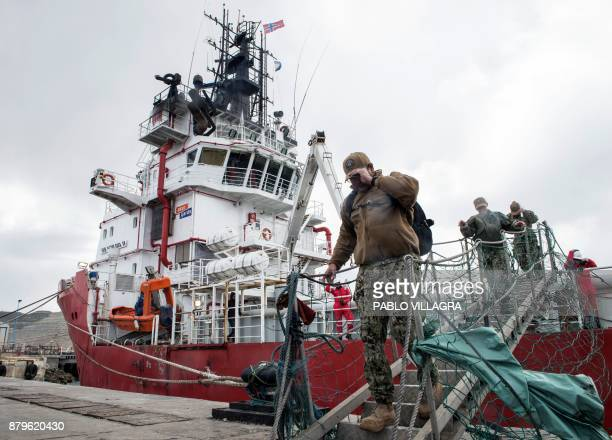 Members of the US Navy Undersea Rescue Command disembark from the Sophie Siem vessel moored at Comodoro Rivadavia harbour after installing their deep...