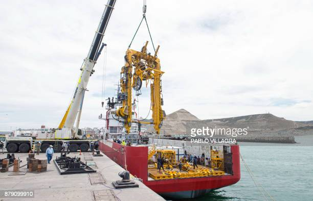 Members of the US Navy Undersea Rescue Command work on the installation of the crane for the Submarine Rescue Diving and Recompression System with a...