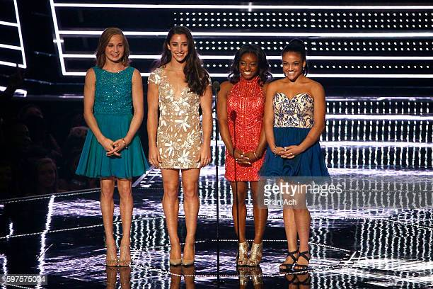 Members of the US Olympic gymnastic team Madison Kocian Aly Raisman Simone Biles and Laurie Hernandez present an award at the 2016 MTV Music Video...