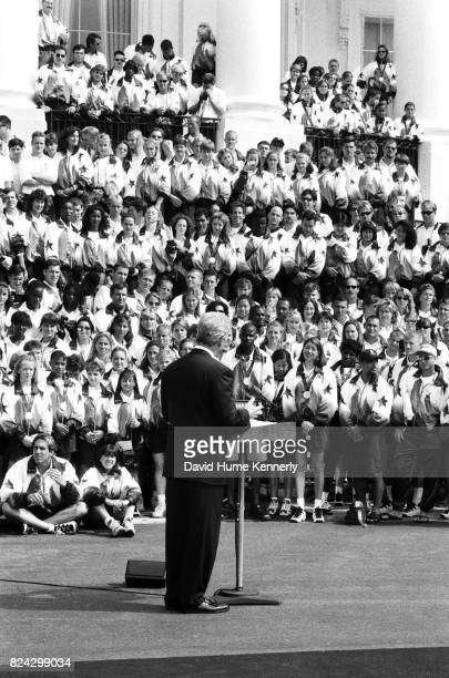 Members of the US Olympic Team listens to remarks from President Bill Clinton on the South Lawn of the White House before a group picture with the...