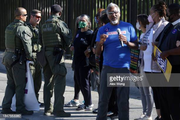Members of the U.S. Park Police arrest voting rights activists as they participate in civil disobedience during a rally outside the White House...