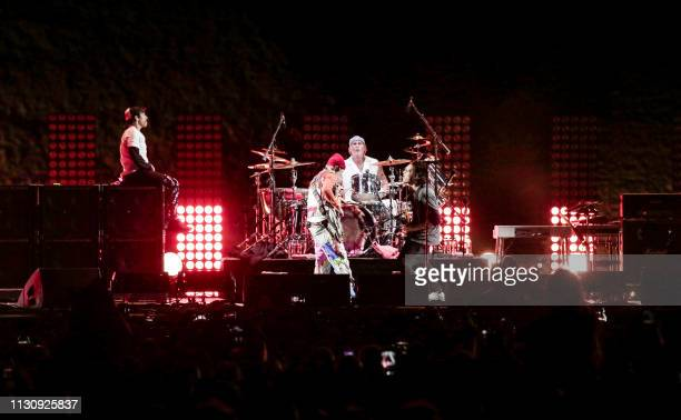 Members of the US rock band the Red Hot Chili Peppers perform during their concert by the Giza Pyramids on the western outskirts of the Egyptian...