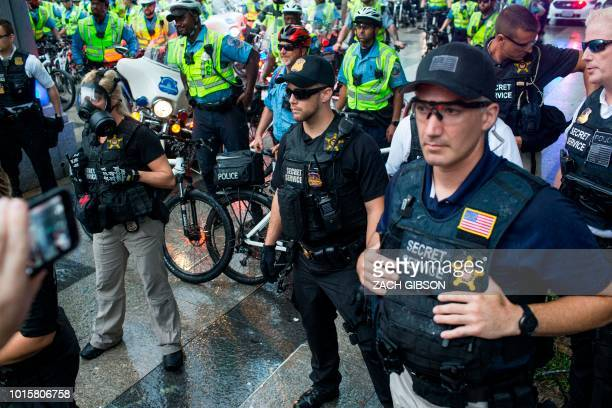 Members of the US Secret Service and DC Metropolitan Police watch as counterprotestors attempt to block the exit from Lafyette Square before Unite...