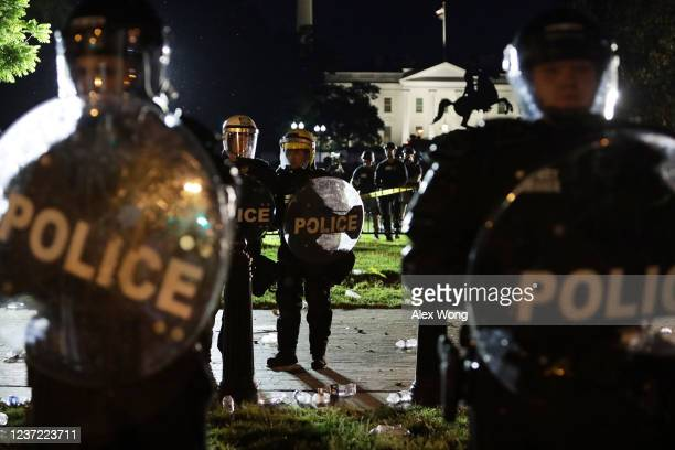 Members of the US Secret Service hold a perimeter near the White House as demonstrators gather to protest the killing of George Floyd on May 30 2020...